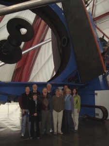 Secretary Clough (second from left in back row) and other members of the group in front of the Magellan telescope at Las Campanas.