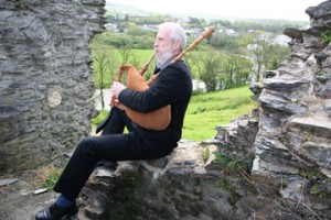 John Evans plays a set of his handcrafted pipes on the ruins of Newcastle Emlyn Castle near his home in the southwest of Wales. Evans crafts both these pipes and a type of traditional Welsh instrument called a 'pibgorn' out of wood, leather and cattle horns. (Photo courtesy of John Evans)