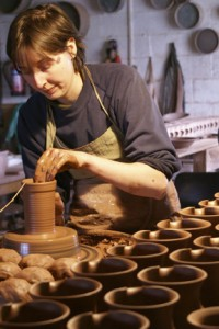 Ninth-generation potter Caitlin Jenkins throws on the wheel at Ewenny Pottery, a family-owned ceramics workshop that has been open in South Wales since 1610. One of two ceramics artists coming to this year's festival, Caitlin will be working and teaching with clay on the National Mall this summer. (Photo courtesy of Caitlin Jenkins)