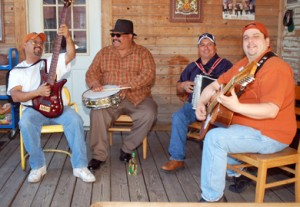 "The Texmaniacs have fun with their conjunto tejano music on audio engineer Joe Treviño's back porch in San Antonio, Texas. Max Baca (right), on the bajo sexto guitar, says conjunto began with its early pioneers ""listening to the German oompah music on the radio in the late 1920s. They would imitate, but in doing so they created their own sound."" (Photo by Daniel Sheehy)"