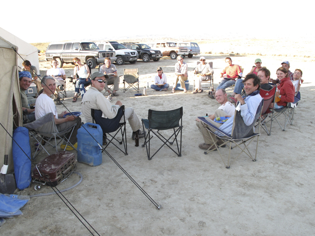 At the end of the day, the teams gather at the base camp to discuss the day's finds. (Photo by Wayne Clough)