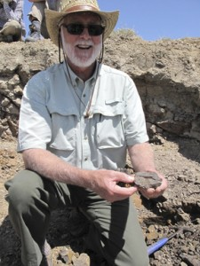 Wayne Clough and a fossil leaf he unearthed. (Photo by Scott Wing)