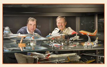 "Thomas Dietz, left, with former astronaut Robert ""Hoot"" Gibson and some of the model aircraft in the Air and Space Museum's collection."