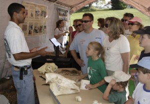 Enthralled visitors talk with a scientist at the 2007 Autum Conservation Festival. (Photo by Mehgan Murphy)
