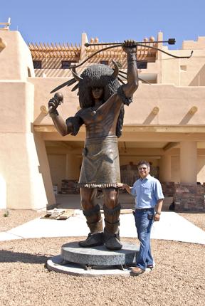"Artist George Rivera with his sculpture ""Buffalo Dancer II"""