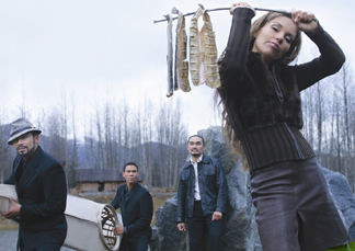 The musical group Pamyua reinterprets traditional Inuit music with African influences to create a sound that reflects their own mixed heritage. From left, Pamyua members Stephen Blanchett, Phillip Blanchett, Ossie Kariaiuak and Karina Moeller, 2003. (Photo by Clark James Mishler, courtesy Pamyua)