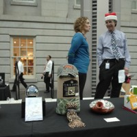 Kristy Snaman, special events manager at the National Portrait Gallery and John Yahner, speechwriter to the Secretary of the Office of Public Affairs supervise the door prizes.