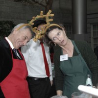Scott Robinson, director of the Office of Special Projects, and Nell Payne, the director of the Office of Government Relations, tangle horns while Era Marshall, the director of the Office of Equal Employment and Minority Affairs looks on with amusement.