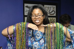 Brittney Oliver displays her collection of beads. (Photo by Harold Dorwin)
