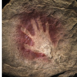 A recreation of this 30,000 year-old handprint, found in France's Chauvet Cave, represents one of the earliest expressions of human creativity. (By Donald Hurlburt and James DiLoreto)