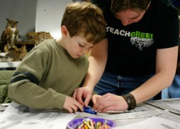 McDonald shows a student how a feather is 'born' by making a clay model. (Photo by Kirsten Bauer)