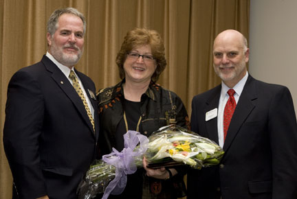 From left, Steve Monfort, associate director of the National Zoo; JoGayle Howard and NZP Director Dennis Kelly