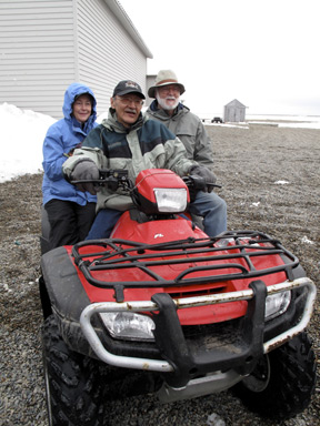 Anne and Wayne Clough get a ride on one of the ubiquitous All-Terrain Vehicles used as transportation in Gambell. (Photo by John Pepper Henry)