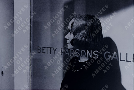 Betty Parsons standing in the doorway of her gallery, 196-?. Unidentified photographer. Betty Parsons Gallery records and Betty Parsons papers, 1927-1985. Archives of American Art.