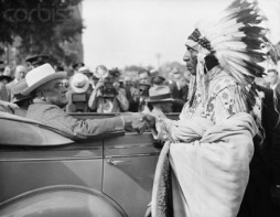 Aug. 29, 1936, Bismarck, North Dakota. During a visit through the western drought area, President Roosevelt shakes hands with Chief Noal Bad Wound, a Sioux Indian. (Image © Bettmann/CORBIS)