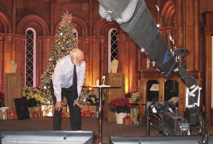 Secretary Clough on the QVC set in the Castle Commons Dec. 2. (Photo by John Gibbons)