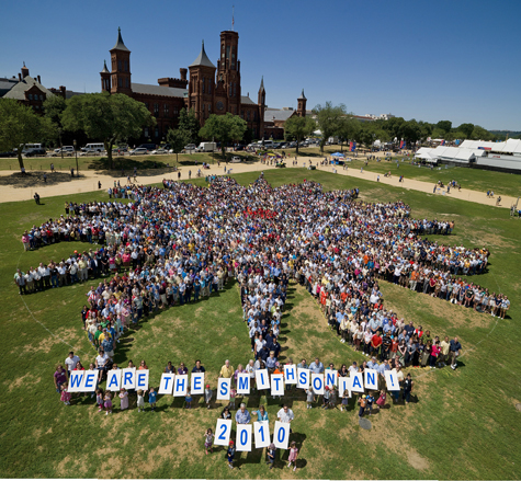 Standing in the shape of the Smithsonian Institution sunburst, close to 4,000 Smithsonian staff, interns, fellows and volunteers gathered on the National Mall in front of the Smithsonian Castle on Thursday, July 1, for this group portrait. This was the first-ever attempt to gather the employees and others for a group shot in the Smithsonian's 164-year history and was the largest gathering of Smithsonian employees, fellows, interns, volunteers and retirees to date. The photo was organized by the Smithsonian Community Committee and was taken during the Smithsonian Staff Picnic, held annually on the National Mall. (Photo by Dane Penland)