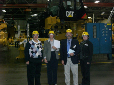 The Smithsonian team visiting the Caterpillar plant in Decatur, Ill.