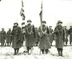 Color Guard of the 442nd RCT stands at attention while citations are read following the fighting in Bruyeres, France, Nov.12, 1944. (Image from the 442nd Veterans Club and Hawaii War Records Depository)