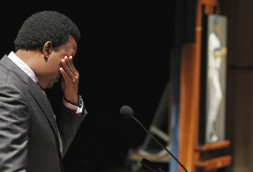 Martinez tears up as his portrait, right, is unveiled at the Smithsonian's National Portrait Gallery. (Photo by Alex Brandon/AP)