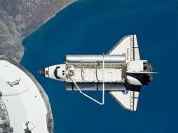 Space shuttle Discovery is seen after leaving the International Space Station where the combined crews of 12 astronauts and cosmonauts worked together for over a week. The area below is the coast of Morocco in the northern Atlantic. Image courtesy NASA, March 7, 2011