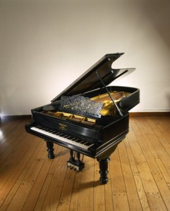 "A Steinway & Sons Grand Piano made in 1892. It was played by Ignace Jan Paderewski on his first United States tour (1892-1893). Paderewski signed the frame, ""This piano has been played by me in 75 concerts during 1892 and 1893."" Courtesy of the Smithsonian Institution."