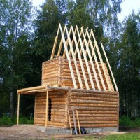 Traditional log house under construction in Mandrogy