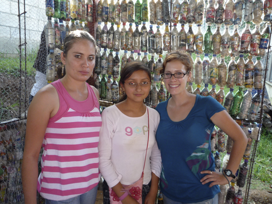 "Peace Corps volunteer Laura Kutner (right) spearheaded efforts to collect trash and build a ""bottle school"" out of discarded plastic bottles in Guatemala. (Photo courtesy of Laura Kutner)"