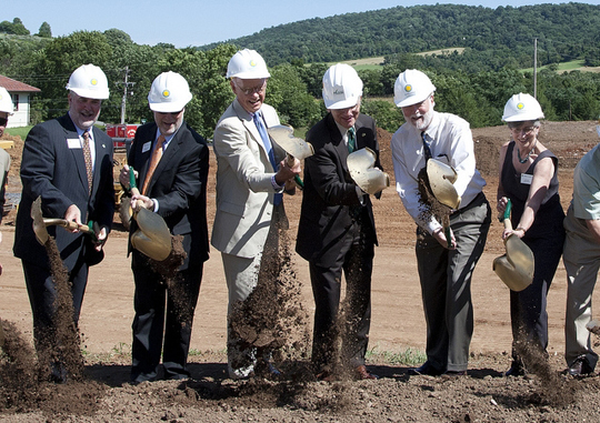 From left, Steve Monfort, Dennis Kelly, Roger Sant, Alan Merten, Wayne Clough and Eva Pell begin the digging for the Smithsonian-Mason Program's new buildings, slated to open fall 2012.