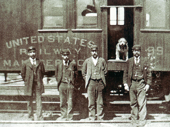 Owney posed for a photograph with his Railway Mail Service clerk friends.