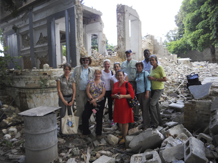 The SI-PCAH delegation visits the devastated Centre d'Art site in Port-au-Prince, Haiti, on June 21, 2011. From left, Stephanie Hornbeck (Chief Conservator, Haiti Cultural Recovery Project); Dr. Richard Kurin (Under Secretary for History, Art, and Culture; Corine Wegener (President, U.S. Committee of the Blue Shield); Eryl Wentworth (ExecutiveDirector, American Institute for Conservation); Rachel Goslins (Executive Director, President's Committee on the Arts and Humanities); Axelle Liautaud (member Centre d'Art board), Dr. Wayne Clough (Secretary); Rosa Lowinger (Conservator, St. Trinity murals project); Olsen Jean Julien (Project Manager, Haiti Cultural Recovery Project); Dr. Johnnetta Cole (Director, National Museum of African Art). (Photo by Erickson Pierre-Louis)