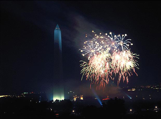 Richard Strauss shot these Desert Storm Victory Celebration fireworks from the roof of the National Museum of American History, 1995, Note the effect of the smoke from the bursts blowing towards the Washington Monument, Smithsonian Photographic Services.