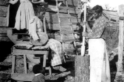 Slaves using a mortar and pestle. (Photo courtesy of the Library of Congress)