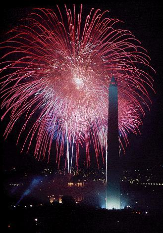 Positioned on the top of the main tower of the Smithsonian Castle Building, Alan Hart captured this sky-filled series of bursts behind the Washington Monument during the Desert Storm Victory Celebration, 1995, Smithsonian Photographic Services.