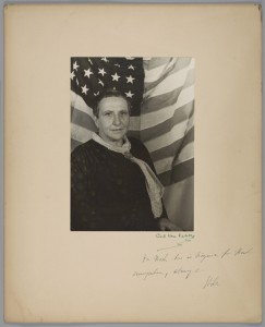 Gertrude Stein with American flag, by Carl Van Vechten. Gelatin silver print on board, January 3, 1935. Rare Books and Special Collections, Boatwright Memorial Library, The University of Richmond,Richmond, Virginia, Carl Van Vechten-Mark Lutz Collection. Courtesy Carl Van Vechten Trust