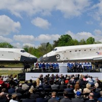 Space Shuttles Enterprise, left, and Discovery meet nose-to-nose at the beginning of a transfer ceremony at the Smithsonian's Steven F. Udvar-Hazy Center, Thursday, April 19, 2012, in Chantilly, Va.