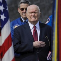 Former astronaut and U.S. Senator John Glenn holds his hand to his heart during the playing of the National Anthem at the transfer ceremony for space shuttle Discovery, Thursday, April 19, 2012, at the Smithsonian's Steven F. Udvar-Hazy Center. (Photo by NASA/Paul E. Alers)