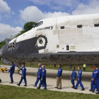 Former astronauts who flew missions on the Space Shuttle Discovery take their places for the welcome ceremony at the Udvar-Hazy Center April 19. (Photo by John Gibbons)