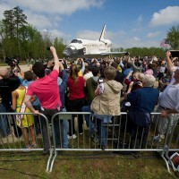 Space shuttle Discovery is rolled toward the transfer ceremony at the Steven F. Udvar-Hazy Center Thursday, April 19, 2012 in Chantilly, Va. Discovery will be permanently housed at the Udvar-Hazy Center, part of the Smithsonian Institution's Air and Space Museum. (Photo by NASA/Carla Cioffi)