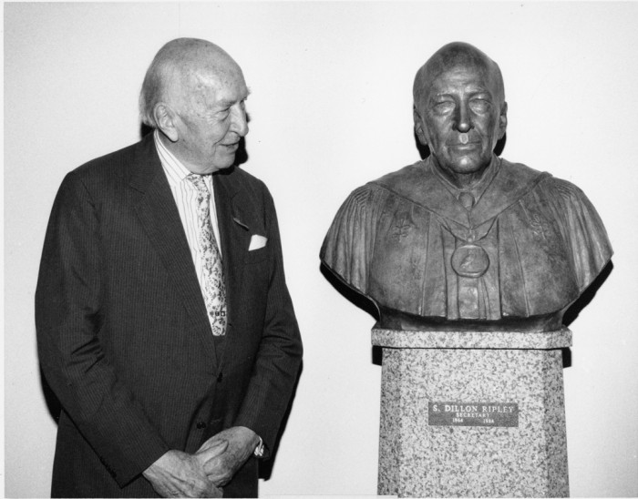 Secretary Emeritus S. Dillon Ripley stands next to the newly unveiled Walker Hancock sculpture that honors Ripley for his 20-year tenure as Secretary