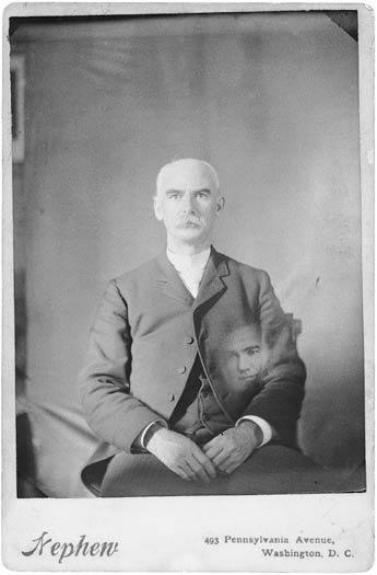 Thomas Smillie with an unidentified disembodied head. Photographer unknown.