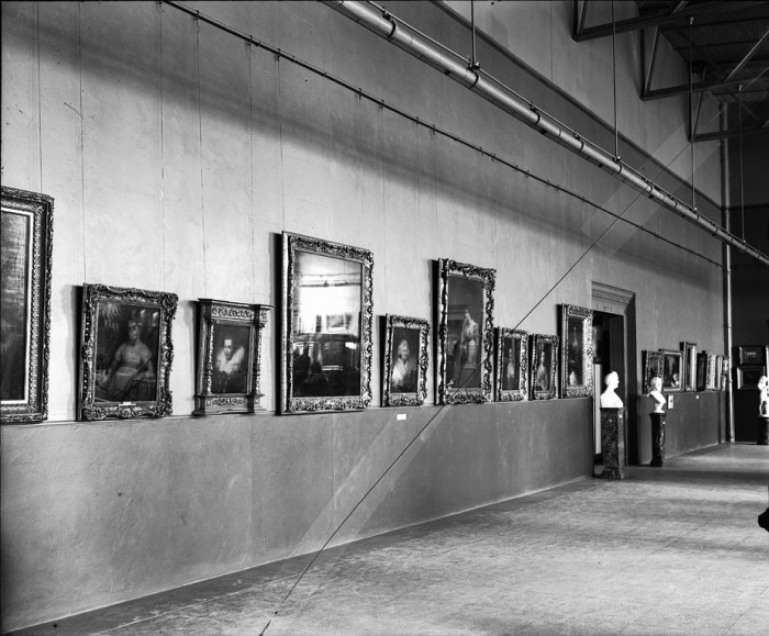 Harriet Lane Johnston Collection exhibited at the National Gallery of Art, now the National Museum of American Art, in the Lecture Hall of the Arts and Industries Building in November of 1906, before it had been entirely remodeled. Photo shows 13 paintings, several busts on pedestals, and a statuette on a floor stand. The Gallery first opened to the public on November 24, 1906
