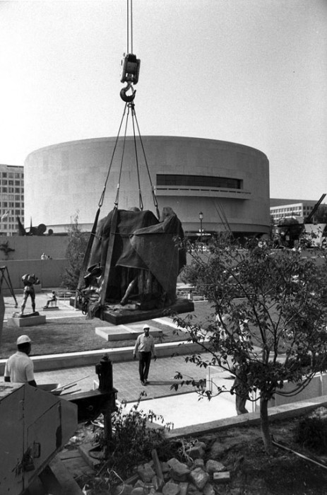 "Auguste Rodin's ""Burghers of Calais"" is airlifted back into the Hirshhorn Museum and Sculpture Garden's sculpture garden after the renovation of the garden. (Photo by Jeff Tinsley, as featured in the Torch, October 1981)"