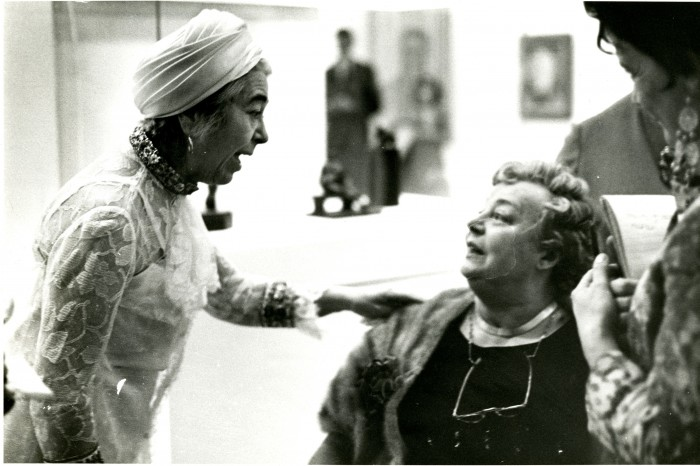 Edith Halpert, on the left, and Mrs. Charles Sheeler, seated, chat during the opening of the memorial exhibition of the work of Charles Sheeler at the National Collection of Fine Arts, now the Smithsonian American Art Museum, on October 9, 1969. Charles Rettew Sheeler, Jr. (July 16, 1883 - May 7, 1965) was an American artist. He is recognized as one of the founders of American modernism and one of the master photographers of the 20th century