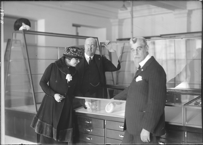 Putting first specimens in a display case in the Museum of the American Indian/Heye Foundation, 155th and Broadway, New York. From L: Mrs. Thea Heye, George Gustav Heye, and MAI trustee Harmon W. Hendricks.