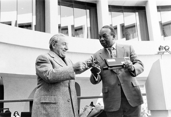 Washington, D.C., Mayor Mayor Walter Washington (right) presents Joseph Hirshhorn with the key to city on the opening day of the Hirshhorn Museum and Sculpture Garden,Oct. 4, 1974. (As featured in the Torch, November 1974.)