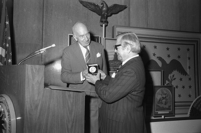 Smithsonian Secretary S. Dillon Ripley (1964-1984) presents Washington, D.C. attorney Ralph E. Becker with the James Smithson Medal. (Photo by Richard Hoffmeister, as featured in the Torch, December 1975)