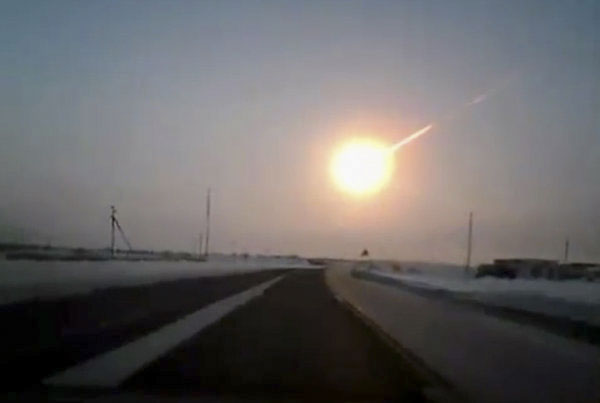 In a screen grab from video taken by a dashboard camera, a streak could be seen in the sky on a highway from Kostanai, Kazakhstan to the Chelyabinsk region in Russia. (www.ng.kz, via Associated Press)