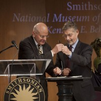 Barry Meyer of Warner Bros. and John Gray, director of the American History Museum, sign the gift agreement.