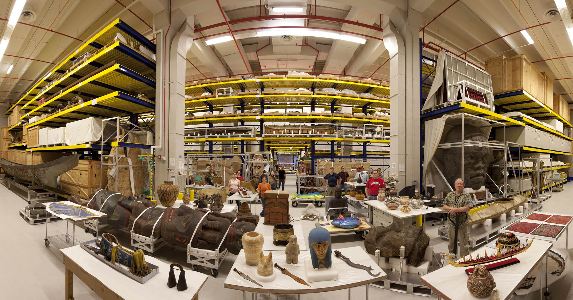 Panoramic view of Pod 4 of the Smithsonian Museum Support Center, with artifacts and staff.
